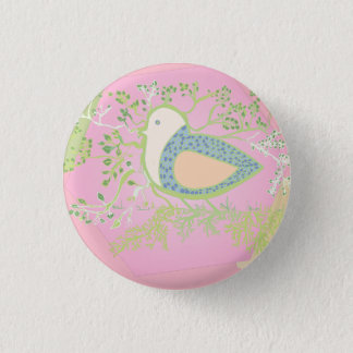 Design of a bird surrounded by tree with branches 3 cm round badge