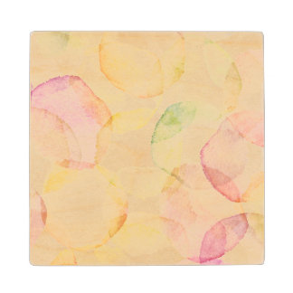 Designed abstract background with watercolor maple wood coaster