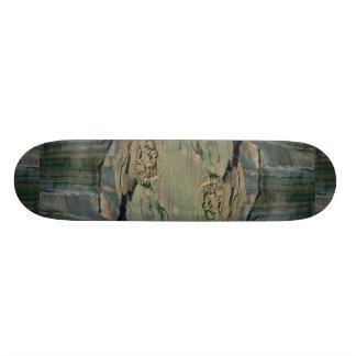 Detail at bottom of cliff custom skate board