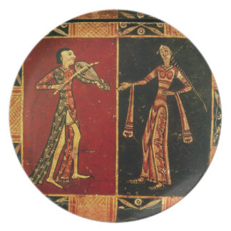 Detail from a wedding chest depicting a musician a dinner plates