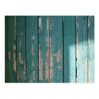 Detail of a green fence from wooden planks postcard