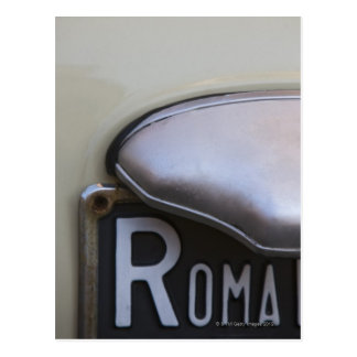 detail of a Roma number plate on a small Italian Postcard