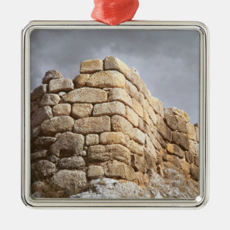 Detail of a stone wall christmas ornament