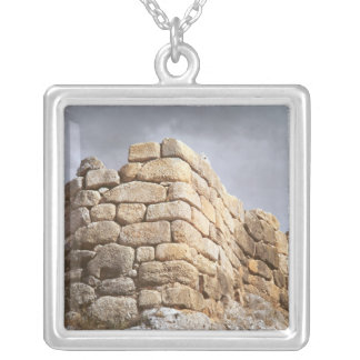 Detail of a stone wall silver plated necklace