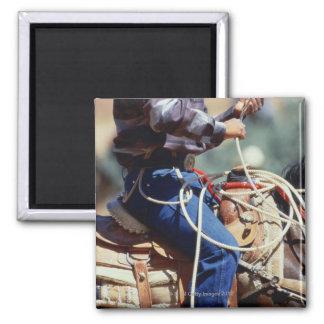 Detail of cowboy on horseback magnet