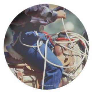 Detail of cowboy on horseback plate