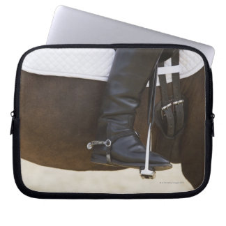 detail of female dressage rider on horse laptop sleeve