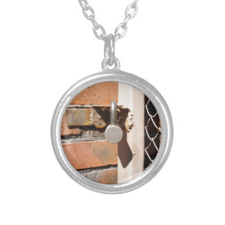 Detail of the gate of the metal mesh that are clos round pendant necklace