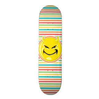 Devil Smiley Face on Bright Rainbow Stripes Skateboard Decks