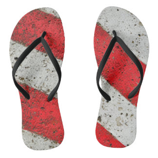 Diagonal red white lines cement texture traffic si flip flops