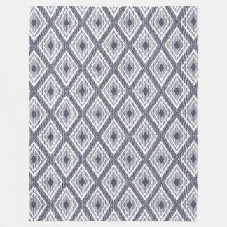 Diamond pattern on navy fleece blanket