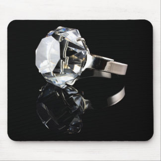Diamond ring on black mouse mat