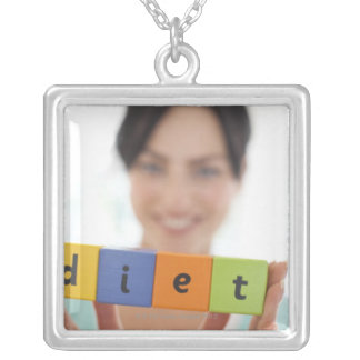 Dieting, conceptual image. necklaces