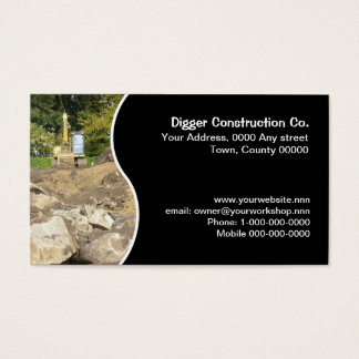Digger on rocky building site business card
