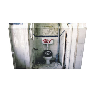 Dilapidated bathroom with graffiti canvas prints
