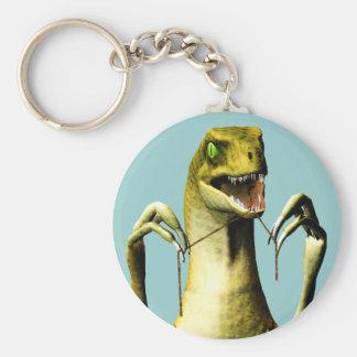 Dinosaur flossing keychain