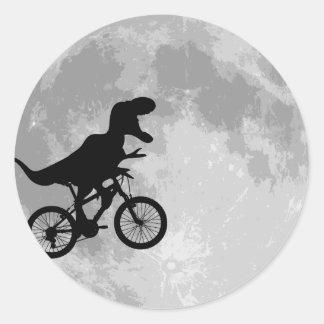 Dinosaur on a Bike In Sky With Moon Round Sticker