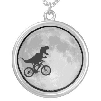 Dinosaur on a bike moon silver plated necklace