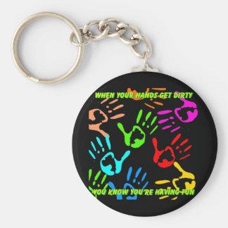 Dirty hands having fun key chains