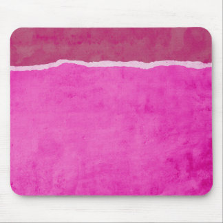 Dirty ripped pink paper mouse mat