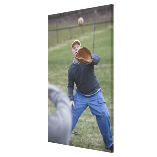 Disabled man playing baseball with his son canvas print