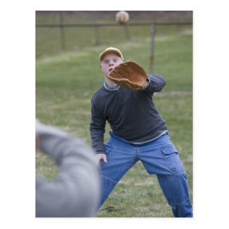 Disabled man playing baseball with his son postcard