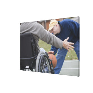 Disabled man playing basketball with his son canvas print