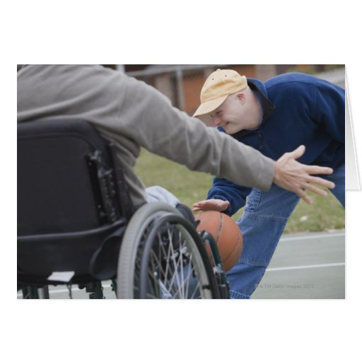 Disabled man playing basketball with his son card