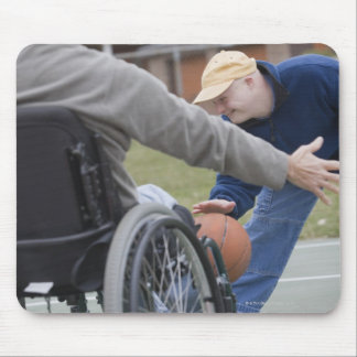 Disabled man playing basketball with his son mouse mat