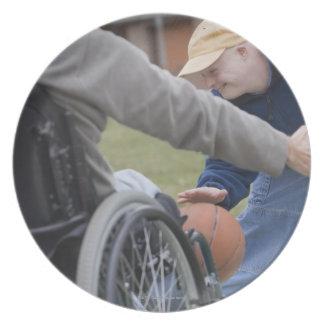 Disabled man playing basketball with his son plate
