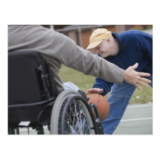 Disabled man playing basketball with his son postcard