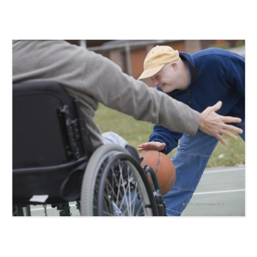 Disabled man playing basketball with his son post card