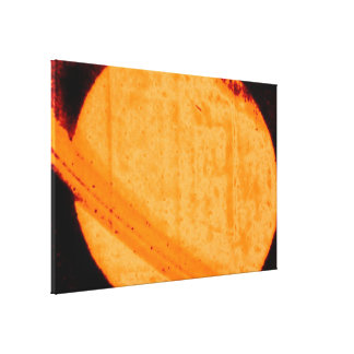Discovery of a Dark Auroral Oval on Saturn Canvas Print
