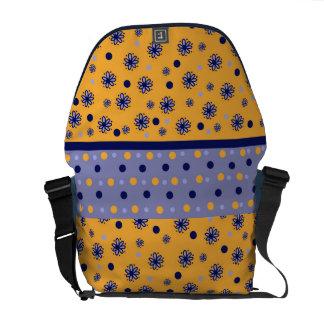 diseño naranja y azul con flores bolsa de mensajería
