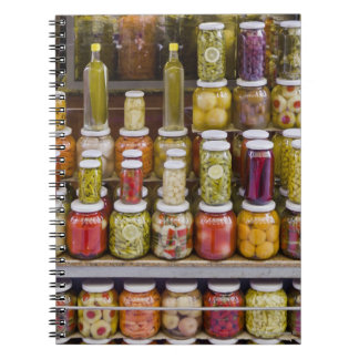 Display of pickled fruits and vegetables. notebooks