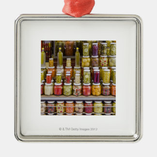 Display of pickled fruits and vegetables. Silver-Colored square decoration