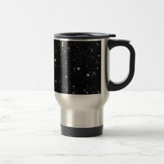 Distant galaxies on a travel mug.