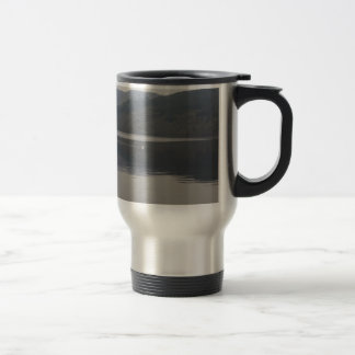 Distant view of a goose swimming peacefully mug