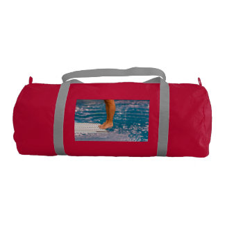 dive from diving board on duffle gym bag
