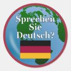 Do you speak German? in German. Flag & globe Classic Round Sticker