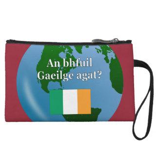 Do you speak Irish? in Irish. Flag & globe Wristlet Clutches