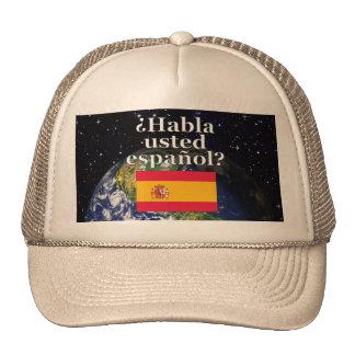 Do you speak Spanish? in Spanish. Flag & Earth Trucker Hat