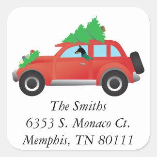 Doberman Pinscher driving car w/ Christmas tree Square Sticker