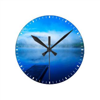 Dock on calm misty lake, California Round Clock