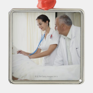 Doctor and nurse tending to patient Silver-Colored square decoration