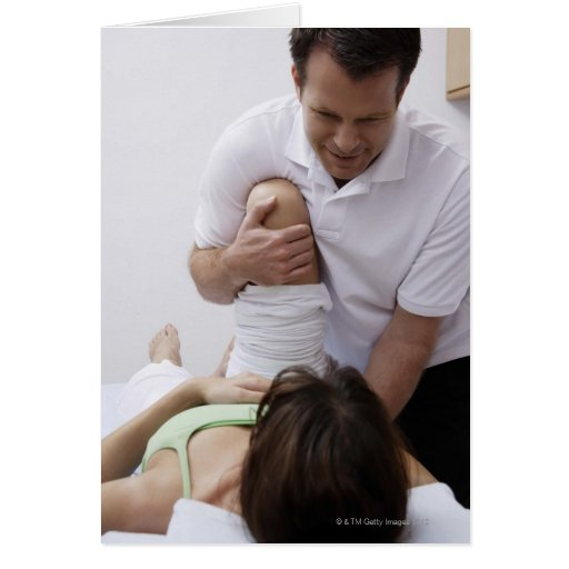 Doctor applying treatment to patient greeting cards