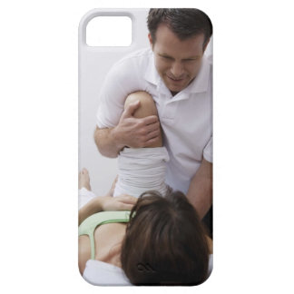 Doctor applying treatment to patient iPhone 5 covers
