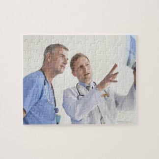 Doctor explaining X-ray to male nurse Jigsaw Puzzle