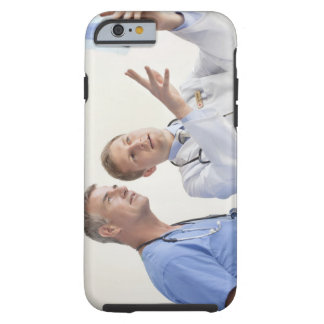 Doctor explaining X-ray to male nurse Tough iPhone 6 Case
