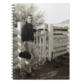 Doctor Standing by a Fence Notebooks